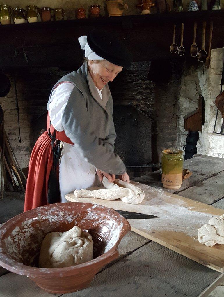Mistress Sarah making bread dough