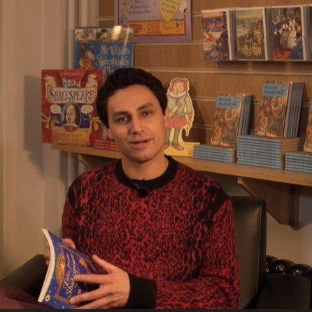 Ben Cajee with story book.jpg