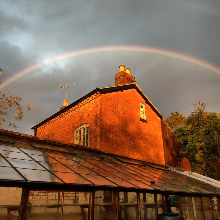 New Place, rainbow over glasshouse