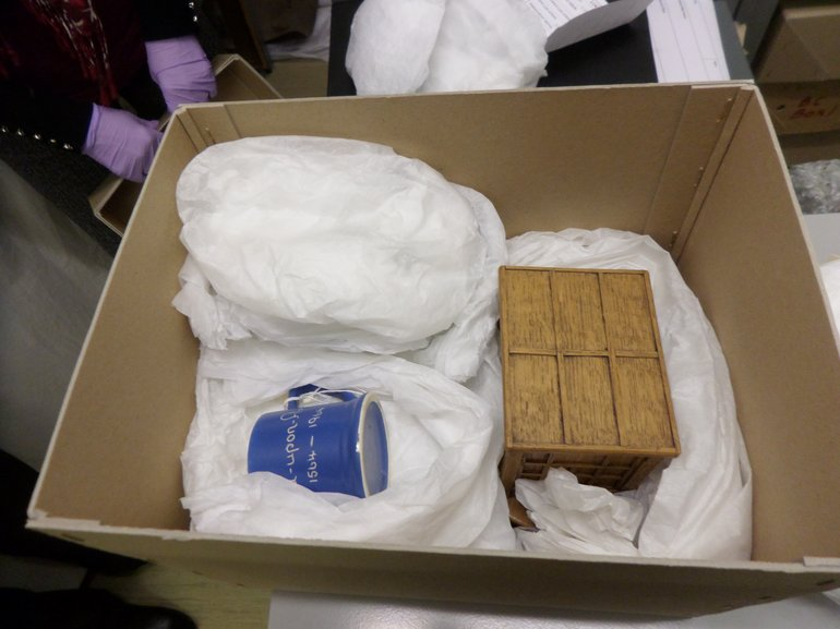 Storing museum items 'nested' in acid free tissue paper.