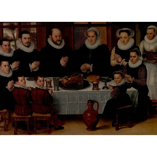 portrait of a family saying grace