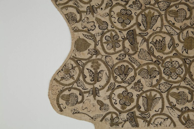 detail of embroidery on coif cap